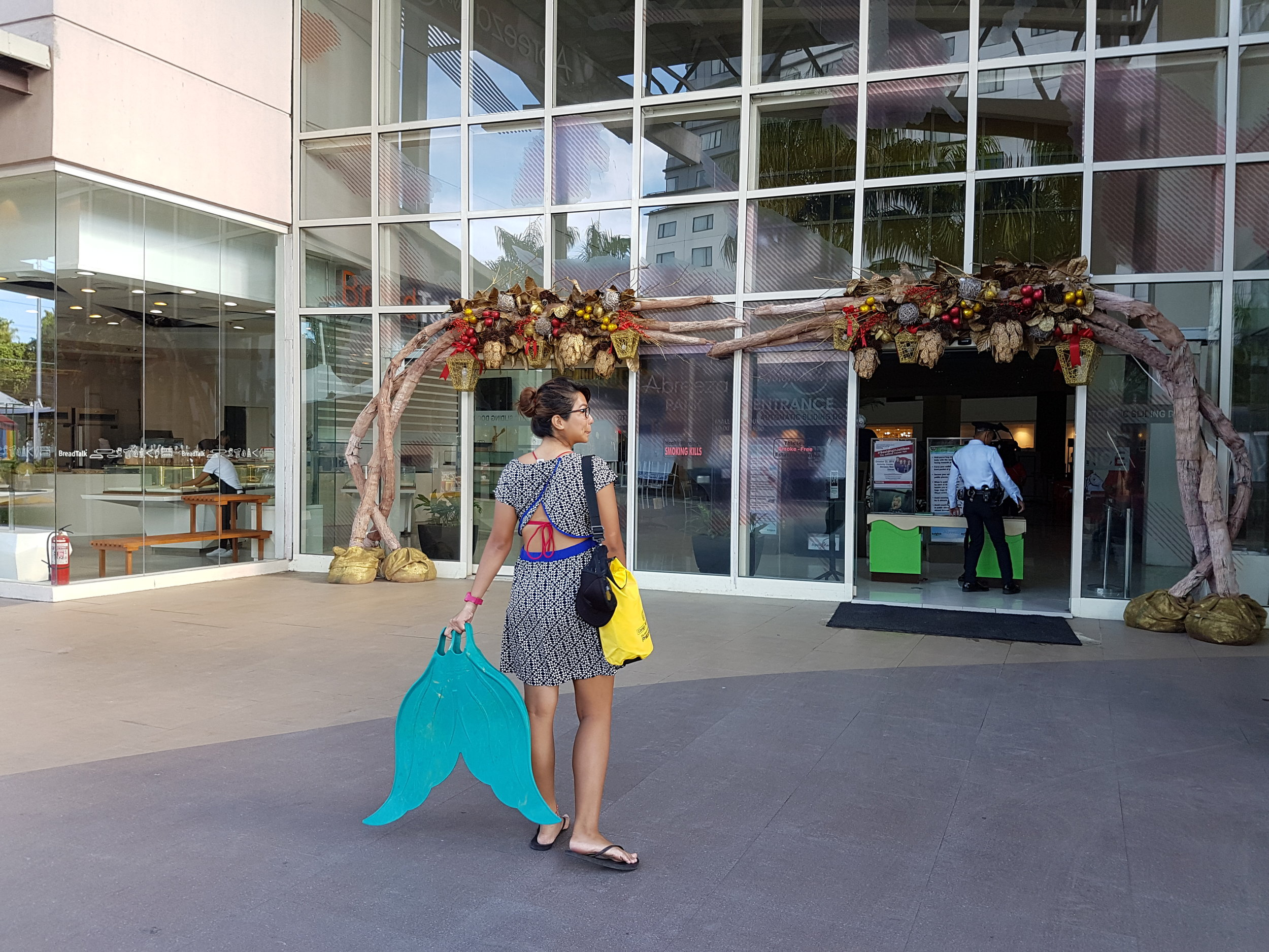Shamelessly walking into malls with your fins - yep, signs of a mermaid. *Overswim / dress: Roxy | Bikini top: Calavera | Dry bag from DOT R13 (yey!)*
