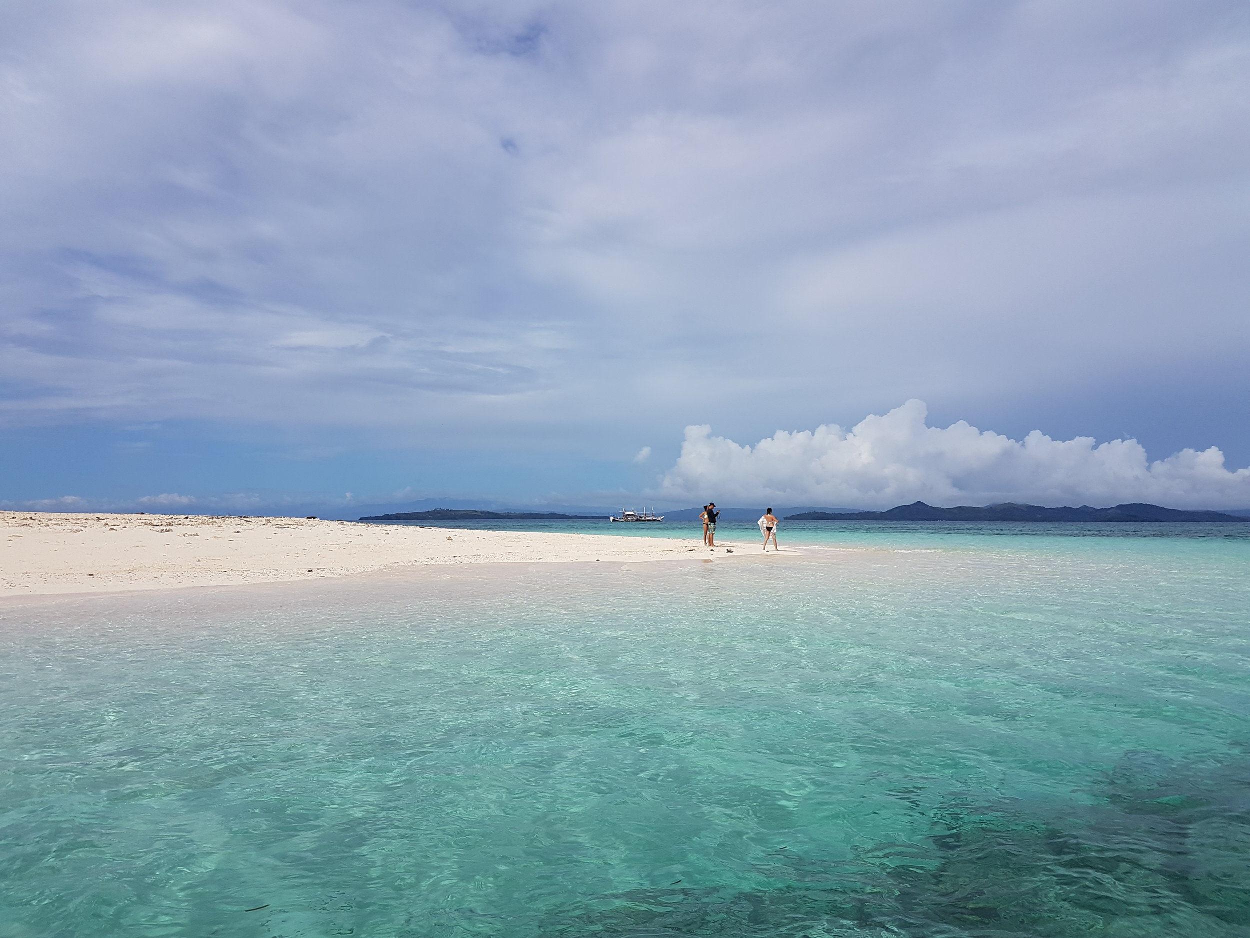 The sandy side of Naked Island is perfect for bumming and getting that glorious tan.
