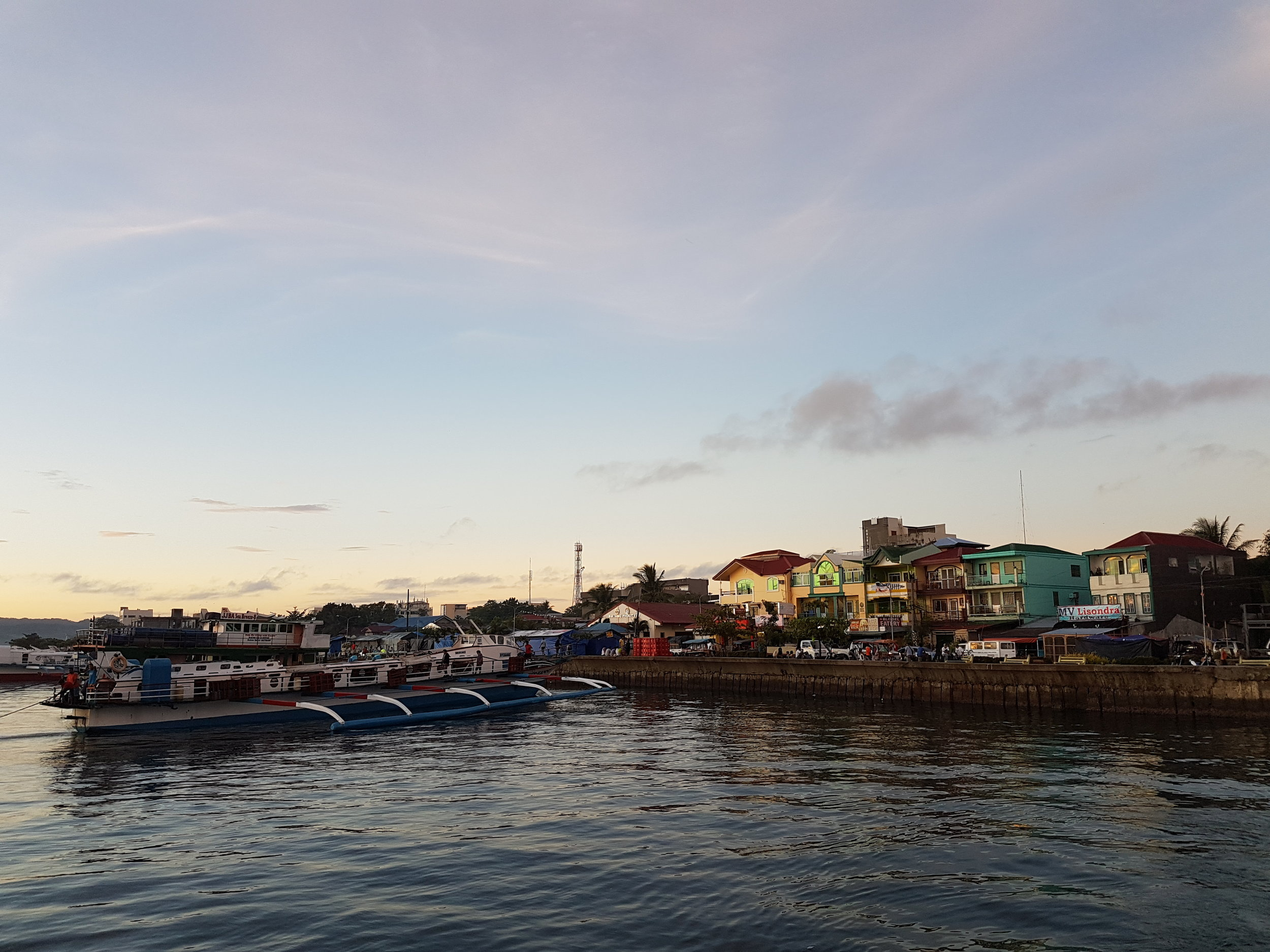 A view of the bustling Surigao City's Boulevard from the sea at quarter to 6:00am in the morning.