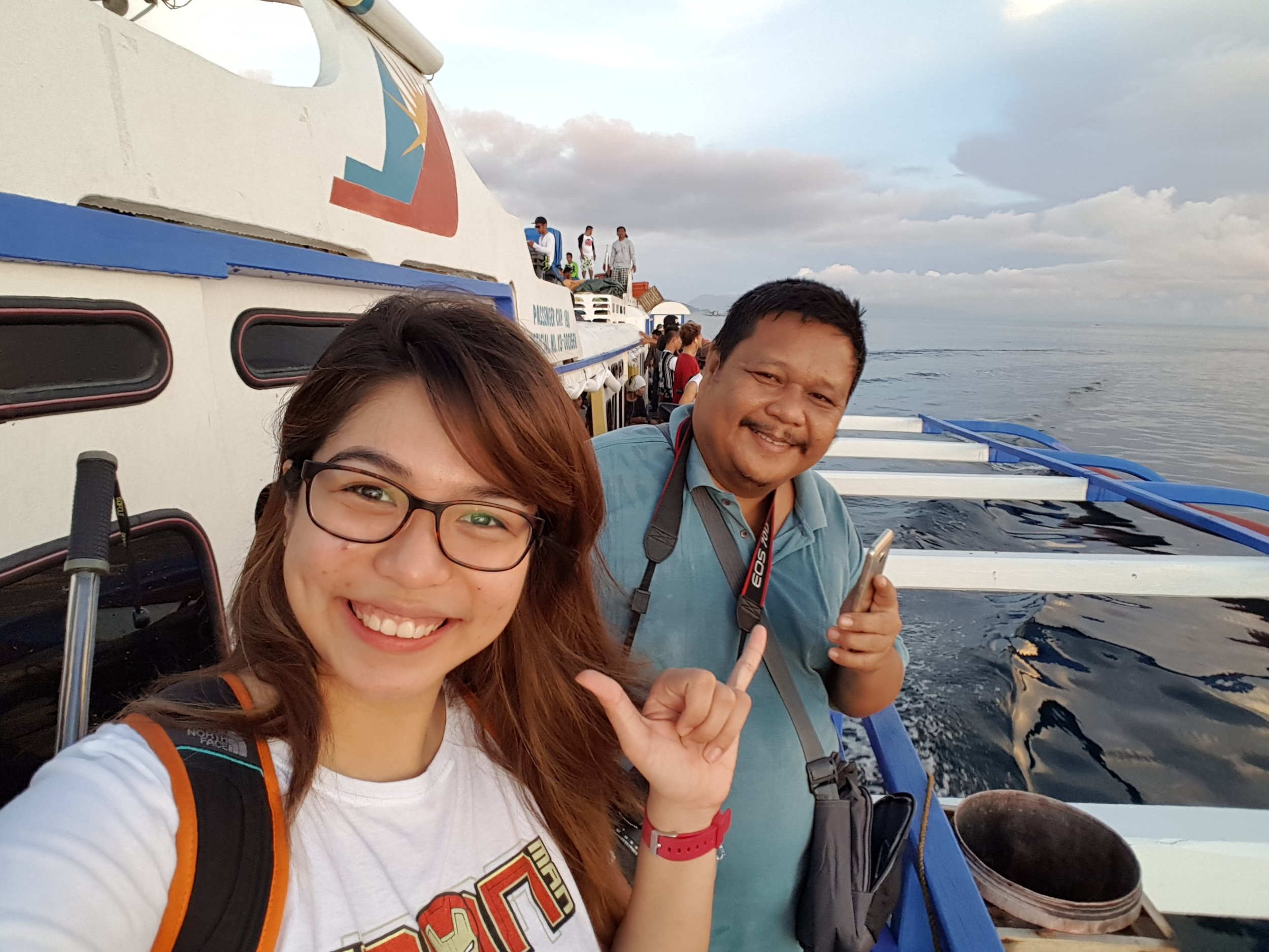 Sir Alex and I having a grand time standing outside the boat on the way to Siargao Island.