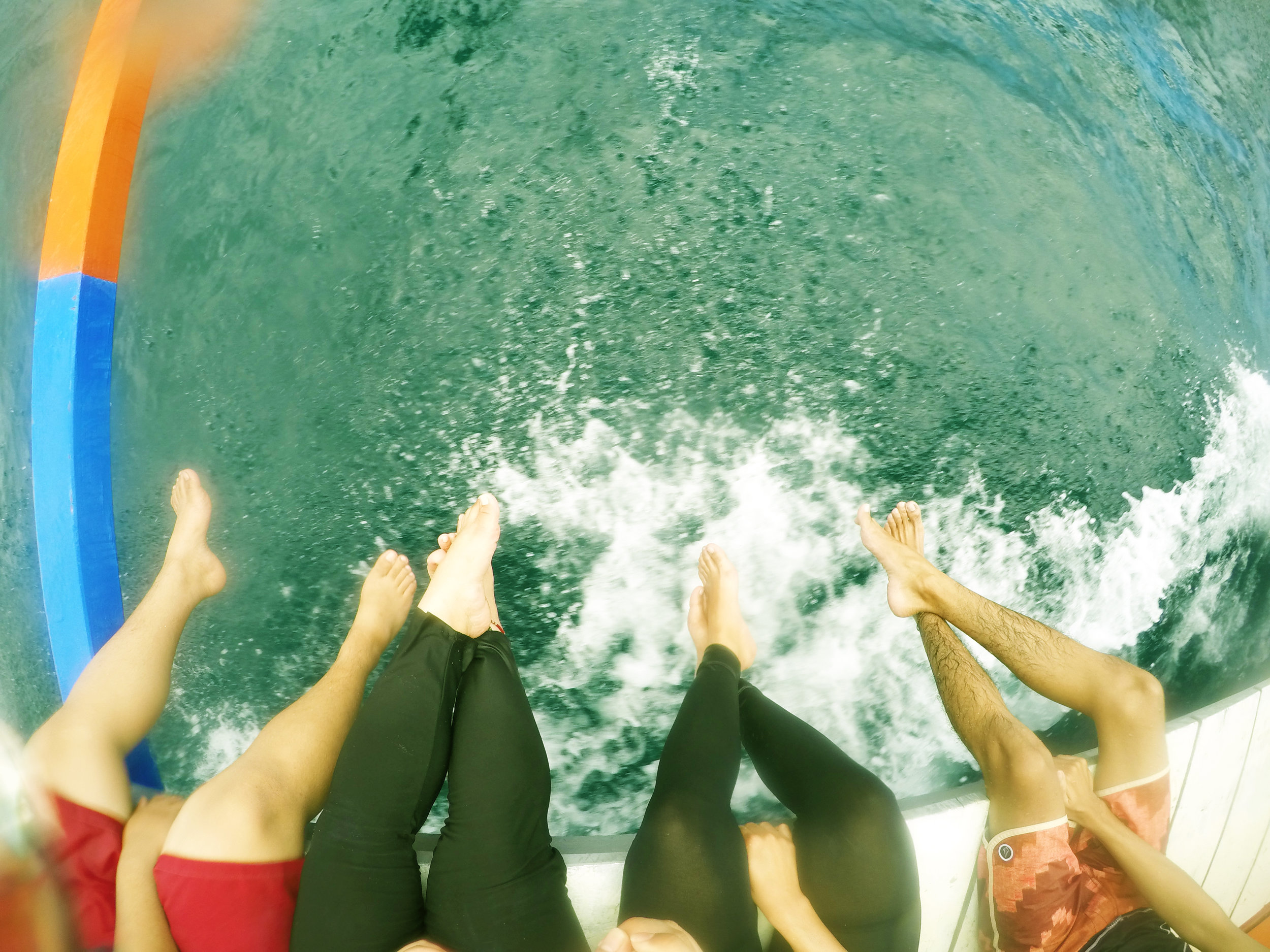 Probably the best part of riding the boat is when you and your friends can dip your feet into the splashing waves. Photo by Bianne Yee