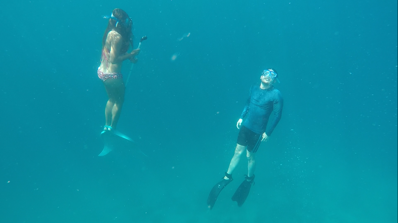 While shooting videos, this is Joshua Abella, and me surfacing for air in Angel's Cove in Talicud Island. Awesome shot by Ael Nayve.