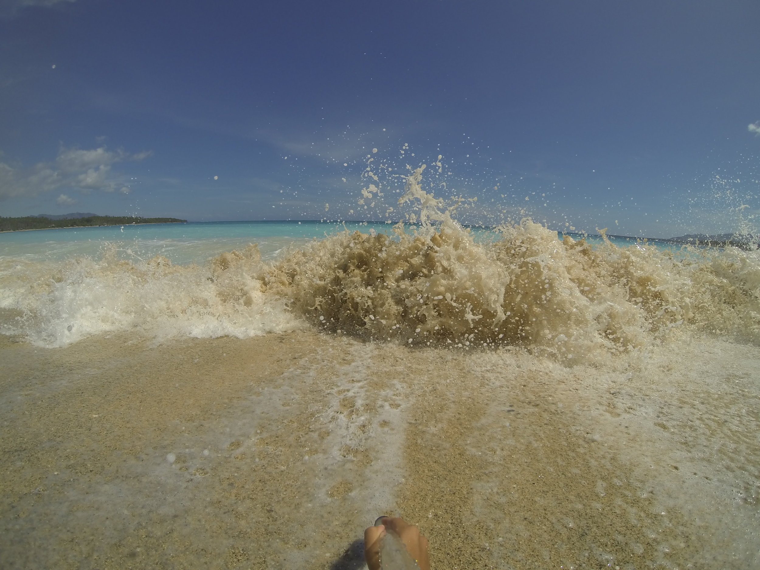 Enjoying the crashing waves of Dahican. Missing these kinds of days.