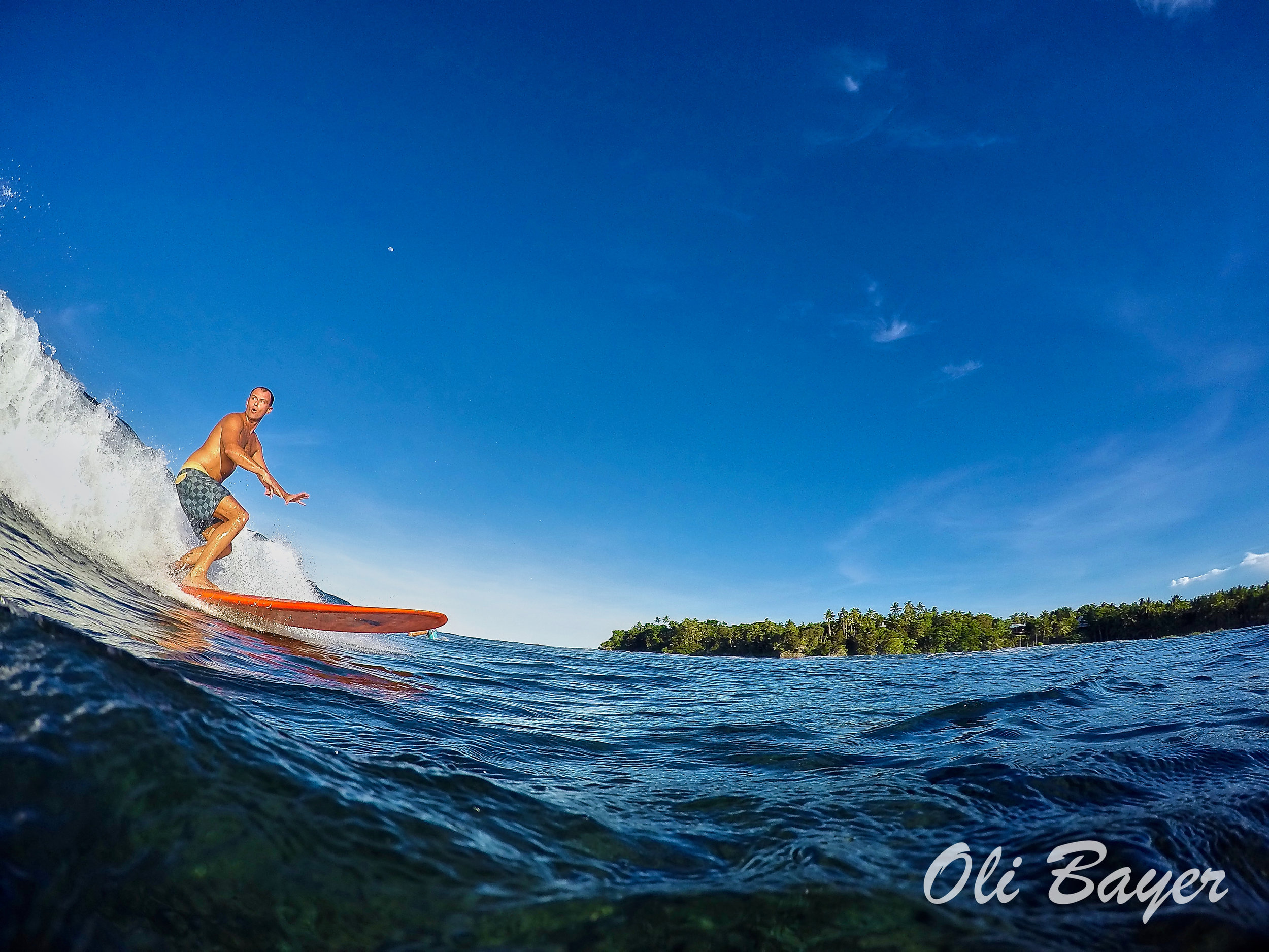 Clear blue skies and riding glassy waves make up the better part of living the island life in Siargao. Photo by Oli Bayer.