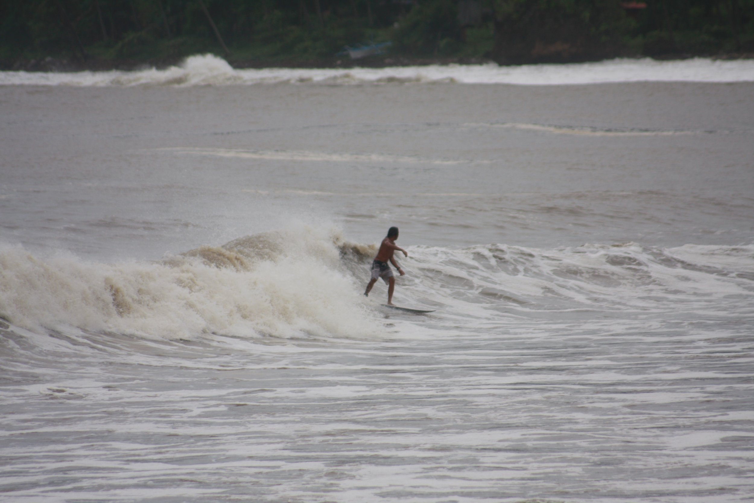 The only shortboarder in our crew, Sandy Santos, makes riding this shoulder-high wave look easy.