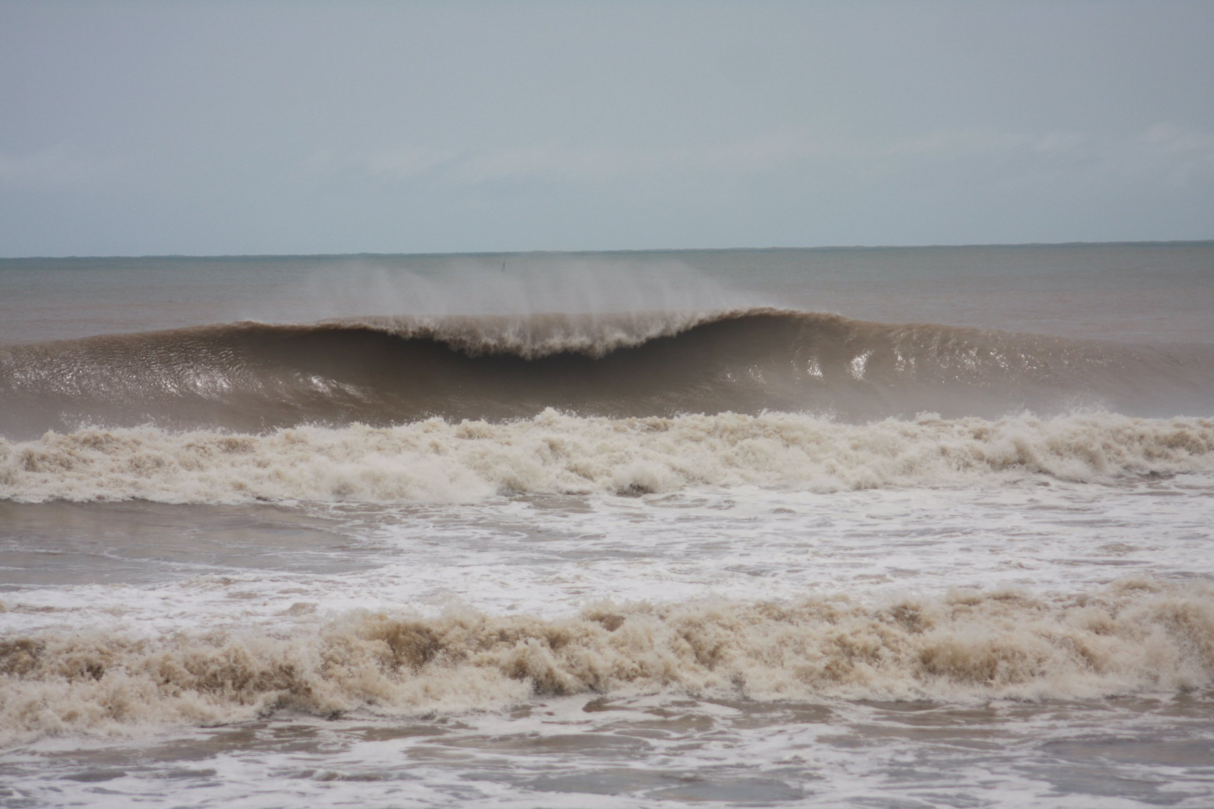 Despite the stormy weather, perfect A-frame waves can be still be seen. This is probably every surfer's dream even with the muddy storm water.