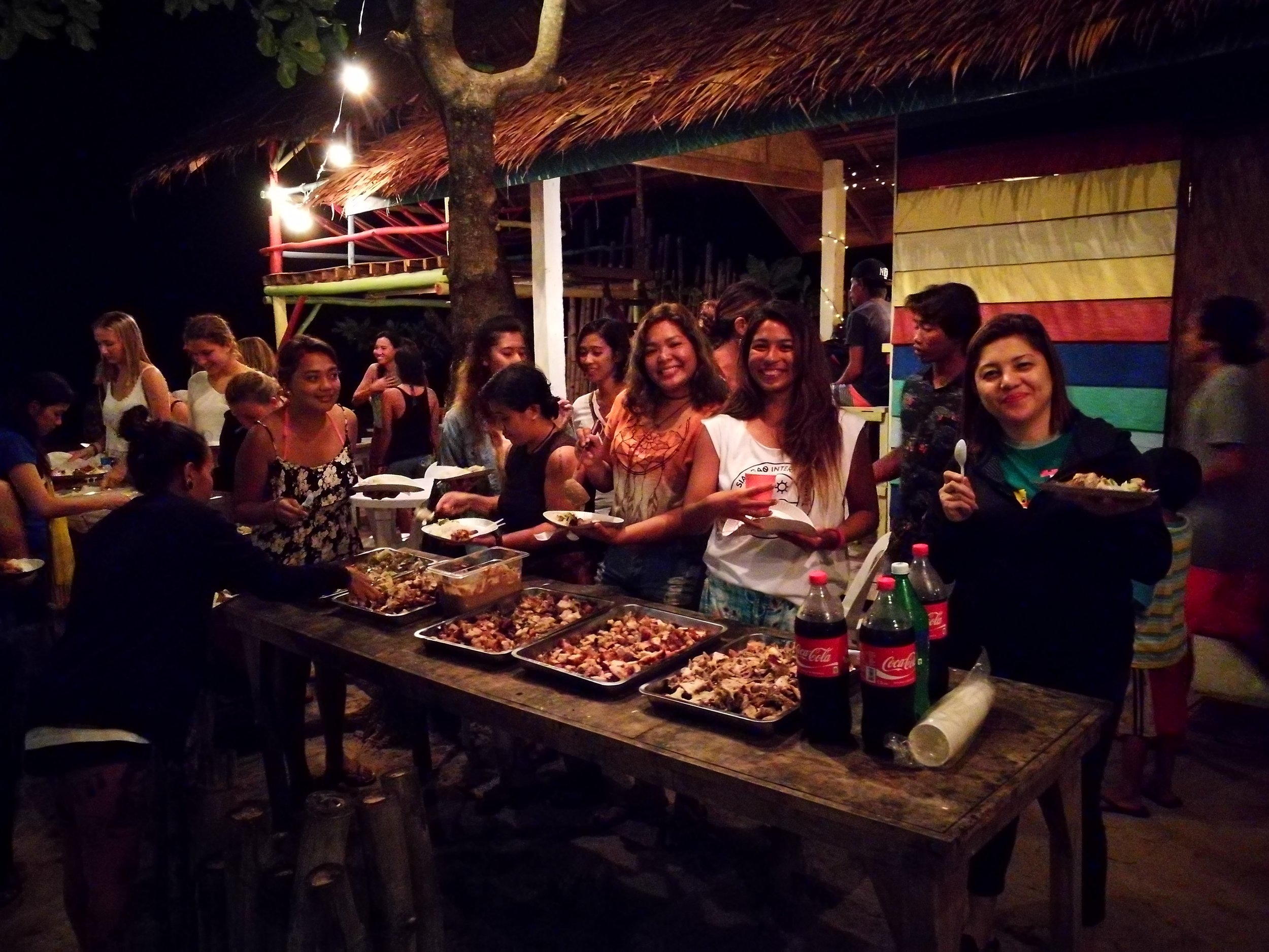 DSR guests, Dahican locals and surfing community get together for dinner prepared by Surf Shack's Jek-Jek Ilagan.