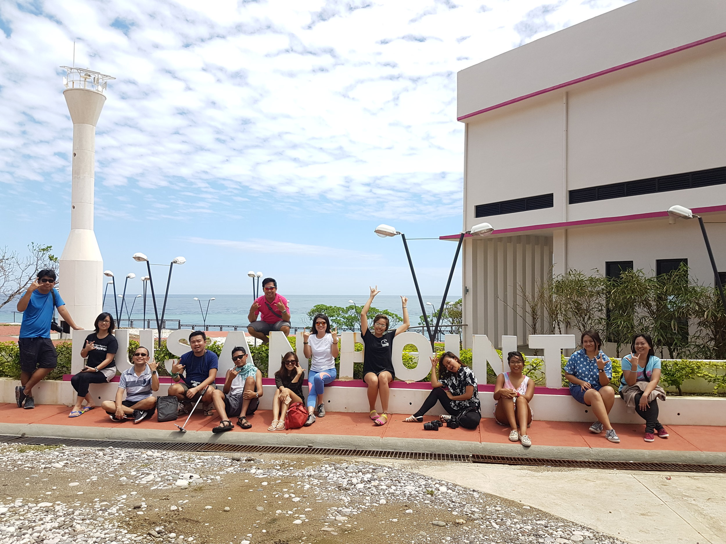 The VDFS team and media at the entrance of Pusan Point.