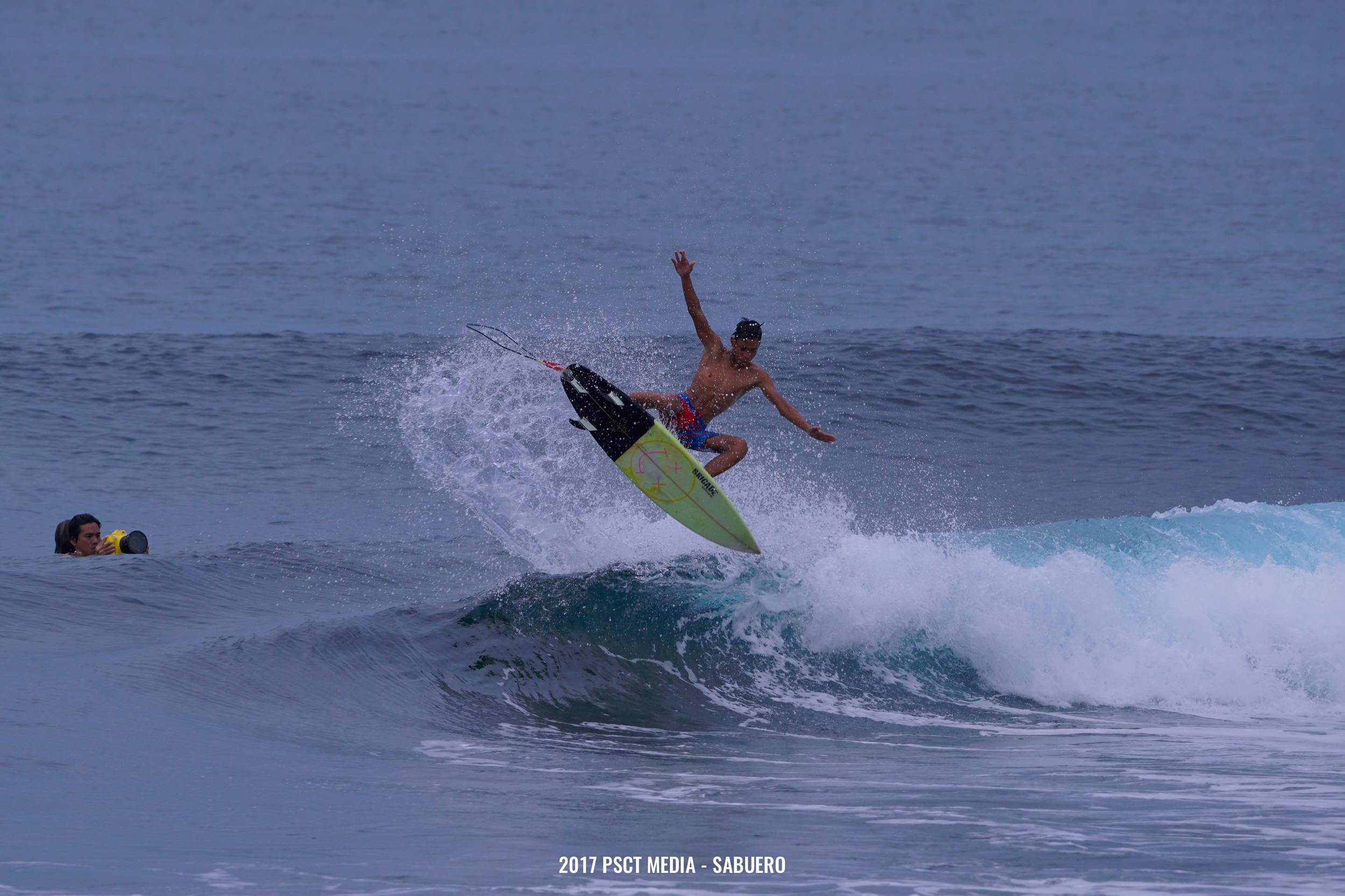 Despite the swell of 1 to 2 foot waves this surfer still pulls tricks. Photo by Gaps Sabuero