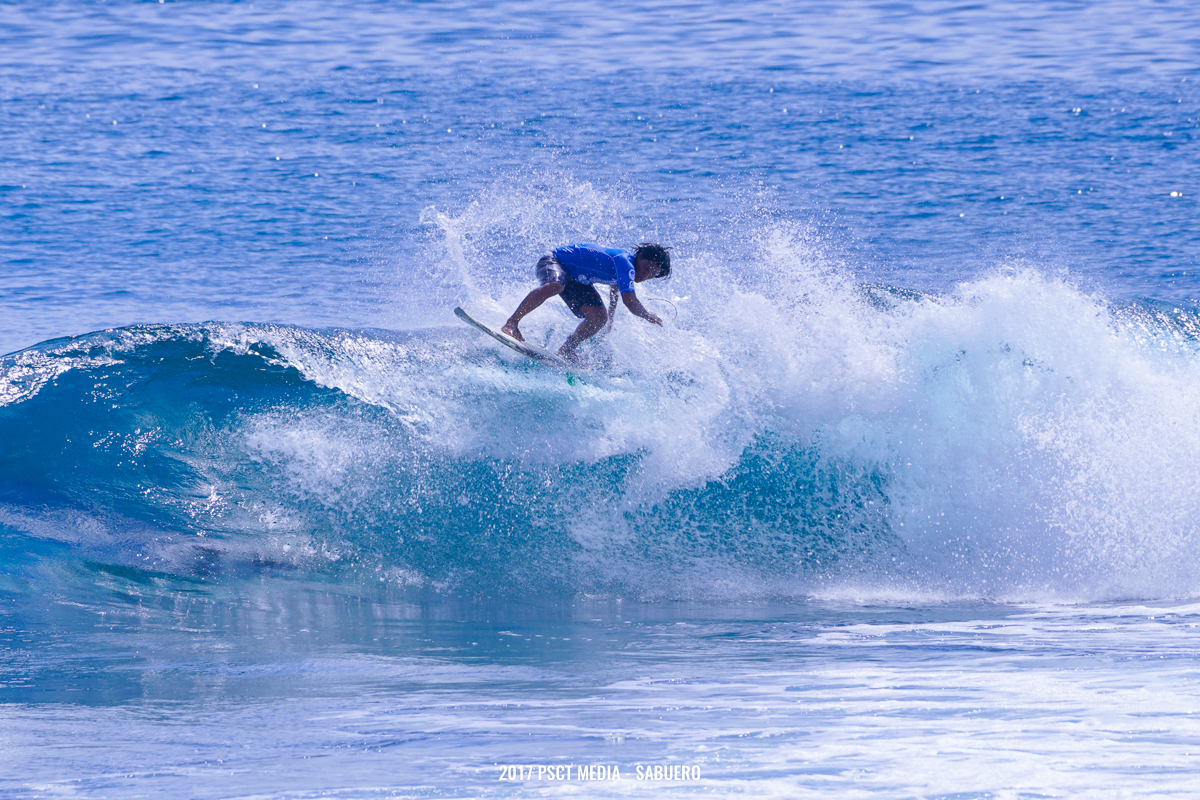 One of the surfers from Round 4 finishes a wave by doing a floater on his backside. Photo by Gaps Sabuero