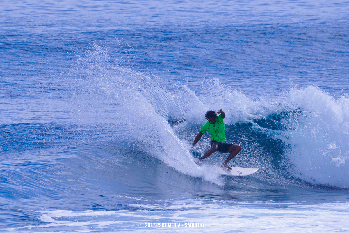 Another surfer showing off a power snap off the top with lots of spray. Photo by Gaps Sabuero