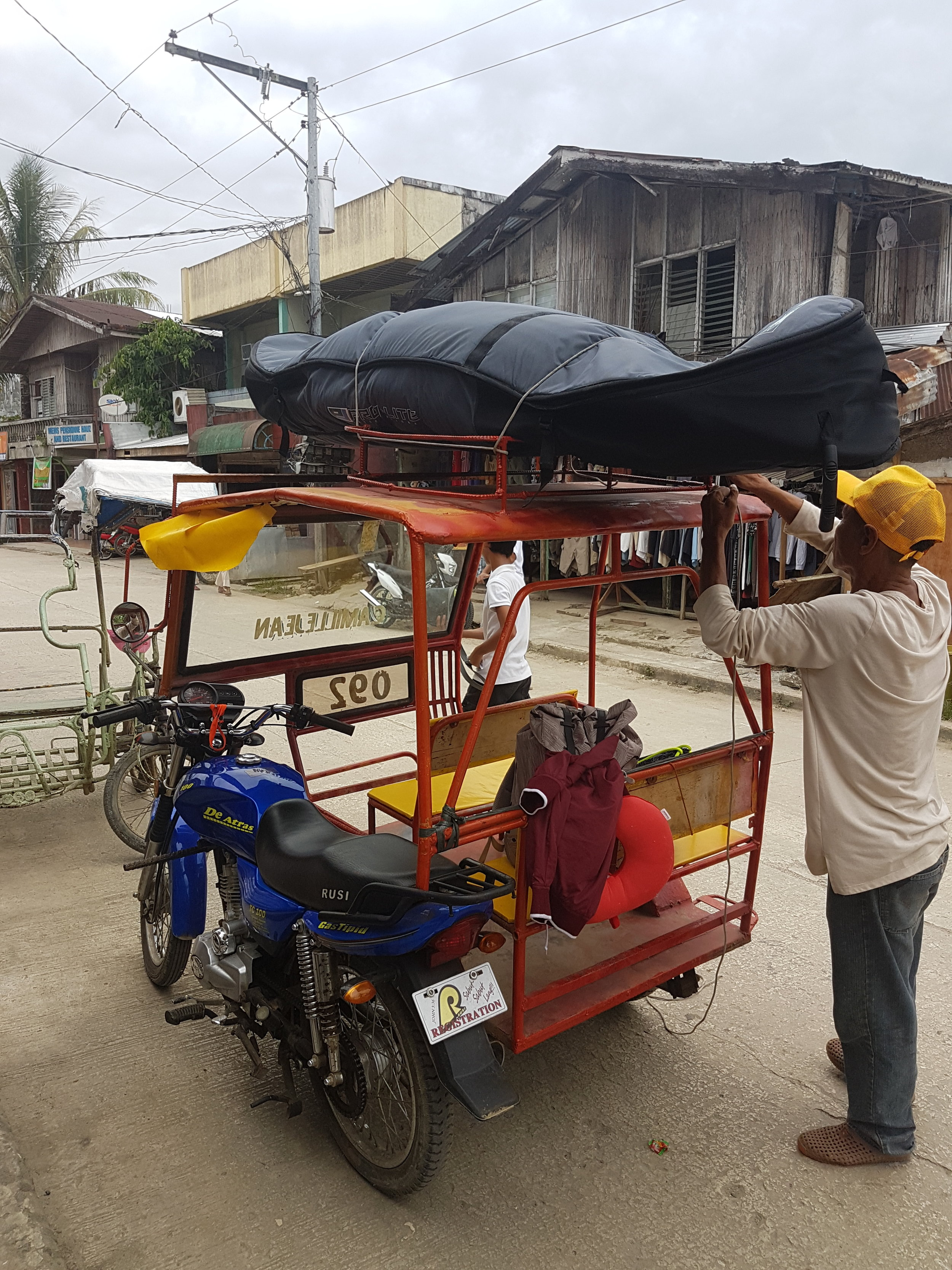 Real struggles of traveling with your surfboard. Taken in Siargao, September 2017.