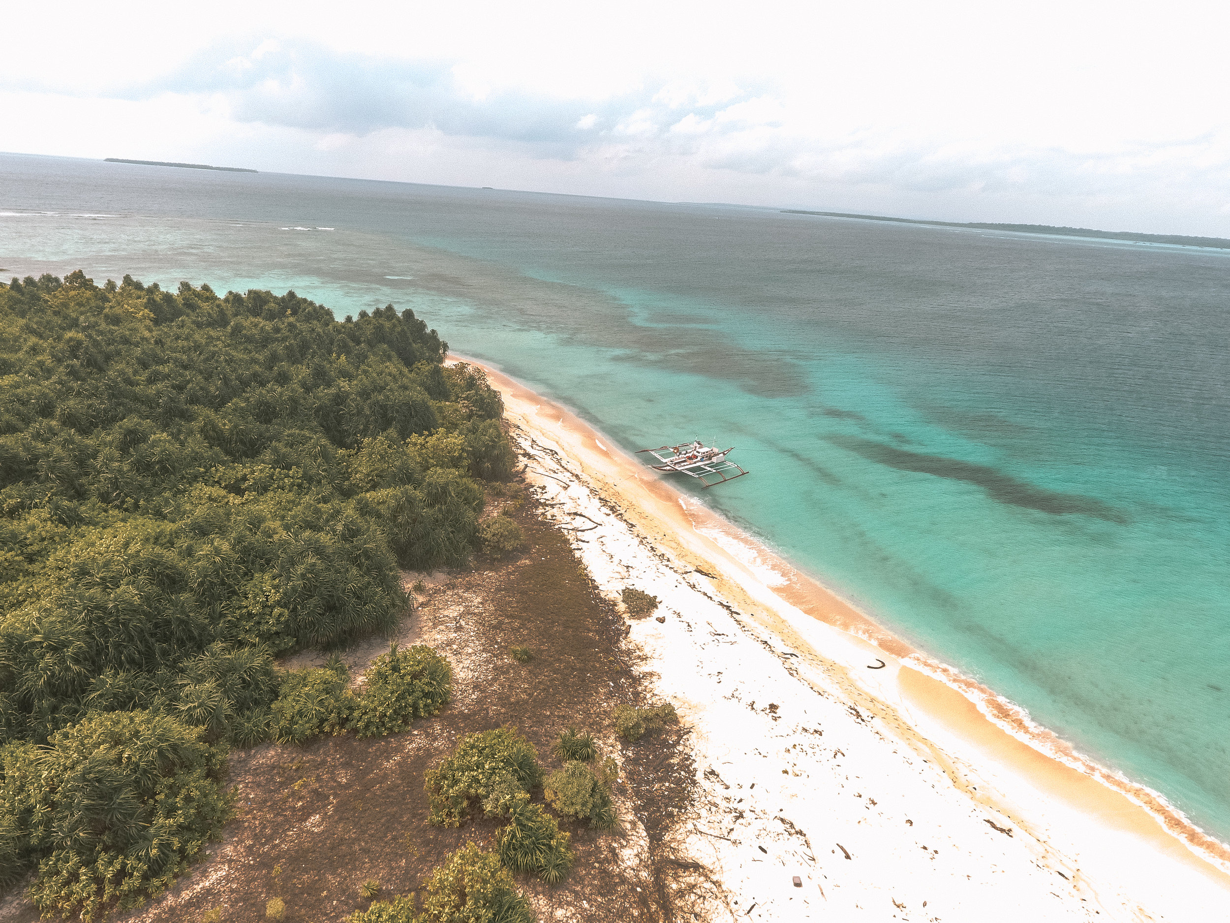 Viewing one of Balabac's many islands from the sky. Photo by Jhasper Reganit.