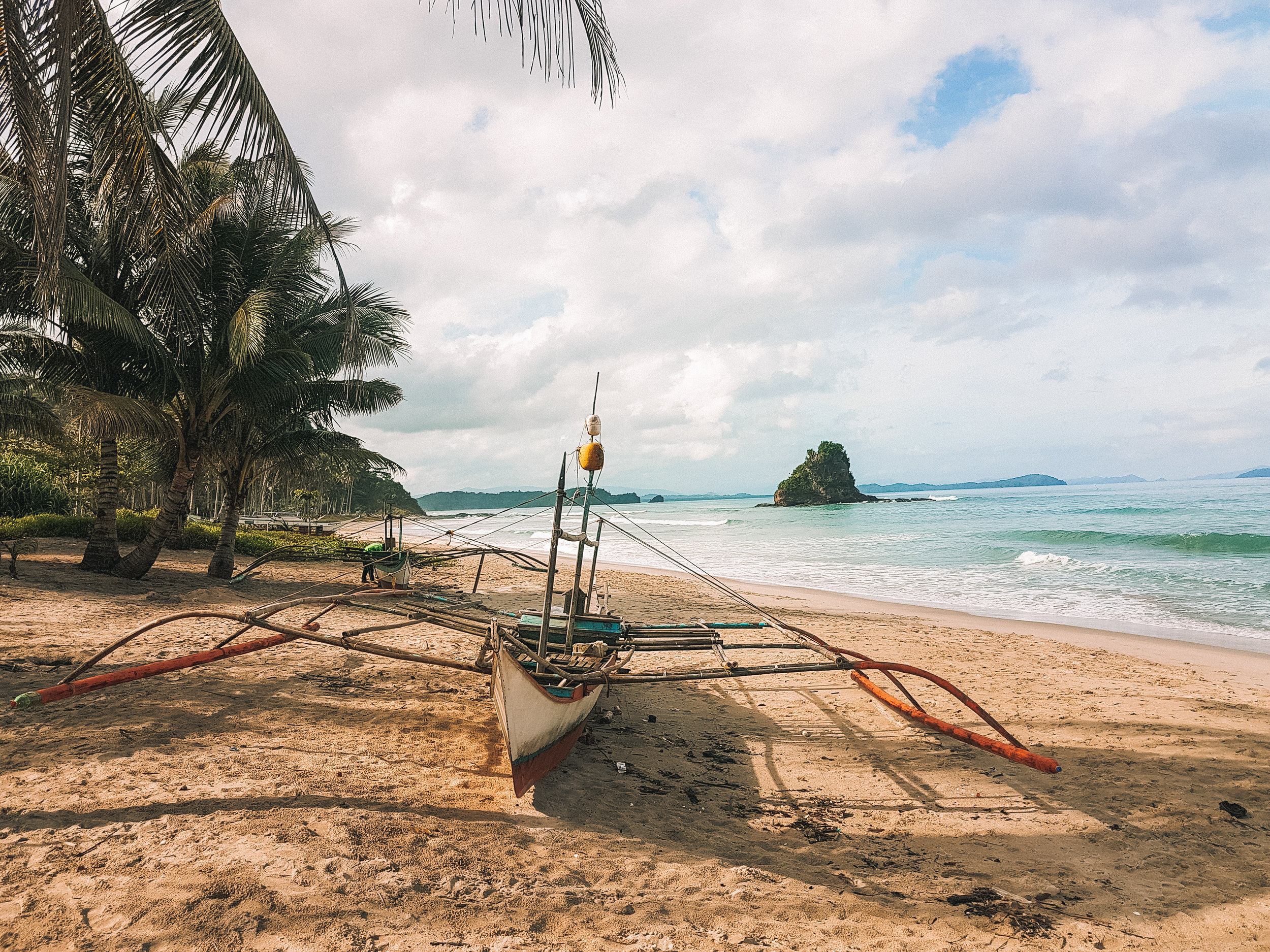 Alimanguan Beach, San Vicente's unmistakable tiny mound of rock where the surf spot is located nearby.