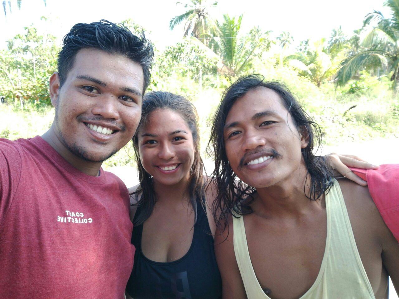 Carlos Mancupang of Balud Coffee House (in red), this mermaid and Connor Bautista of So Surf Mindanao.