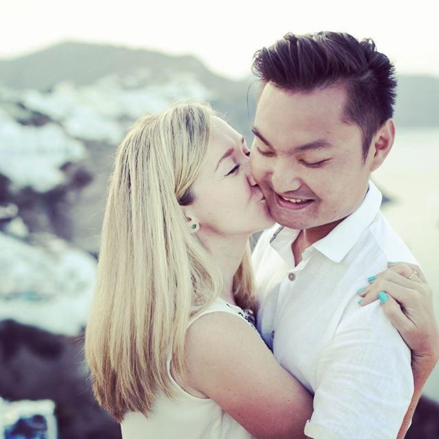 This one was taken in Santorini on our one-year dating anniversary ... #weddingphotography #pannamloda #asianboy #polishgirl #santorini #greece #prewedding #holidays #bridetobe #engaged #mixedcouple #asiasaidyes #singapore #oia