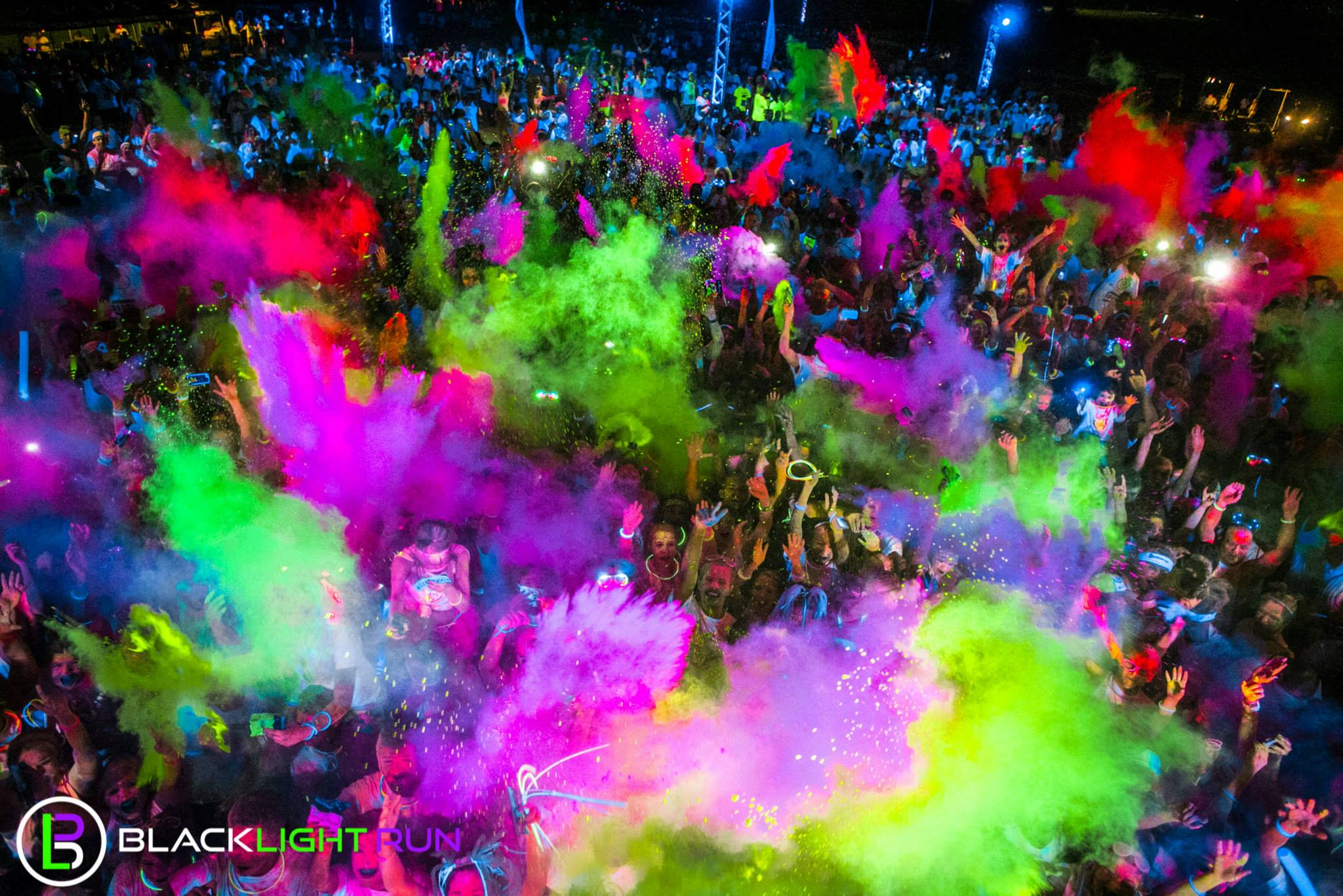 A  Blacklight Run  is a 5k in which participants get doused with a different color glow powder for each milestone they reach. Cool Events LLC runs many similar events all over the country, with portions of proceeds going to cancer research.