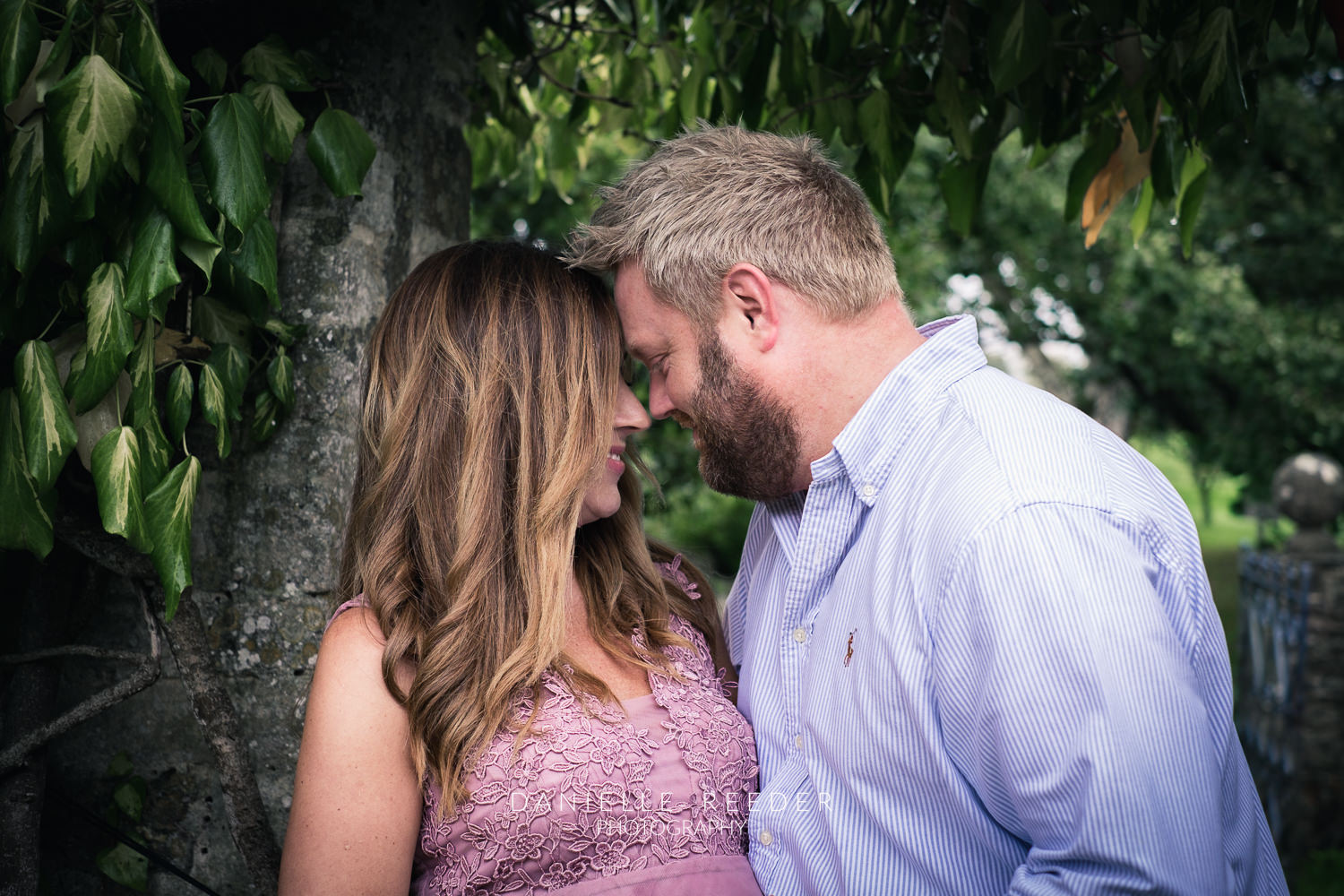 Couple looking lovingly at each other during maternity photoshoot