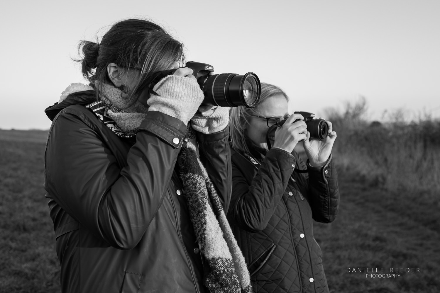 Attendees of course practising with their cameras.