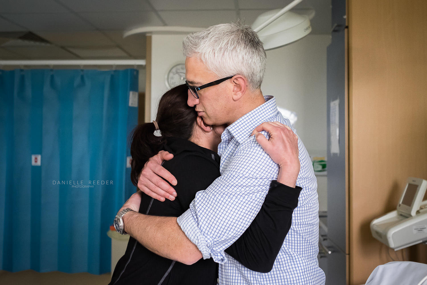 Husband and wife embraced in a tender hug in the delivery suite at Bristol hospital.