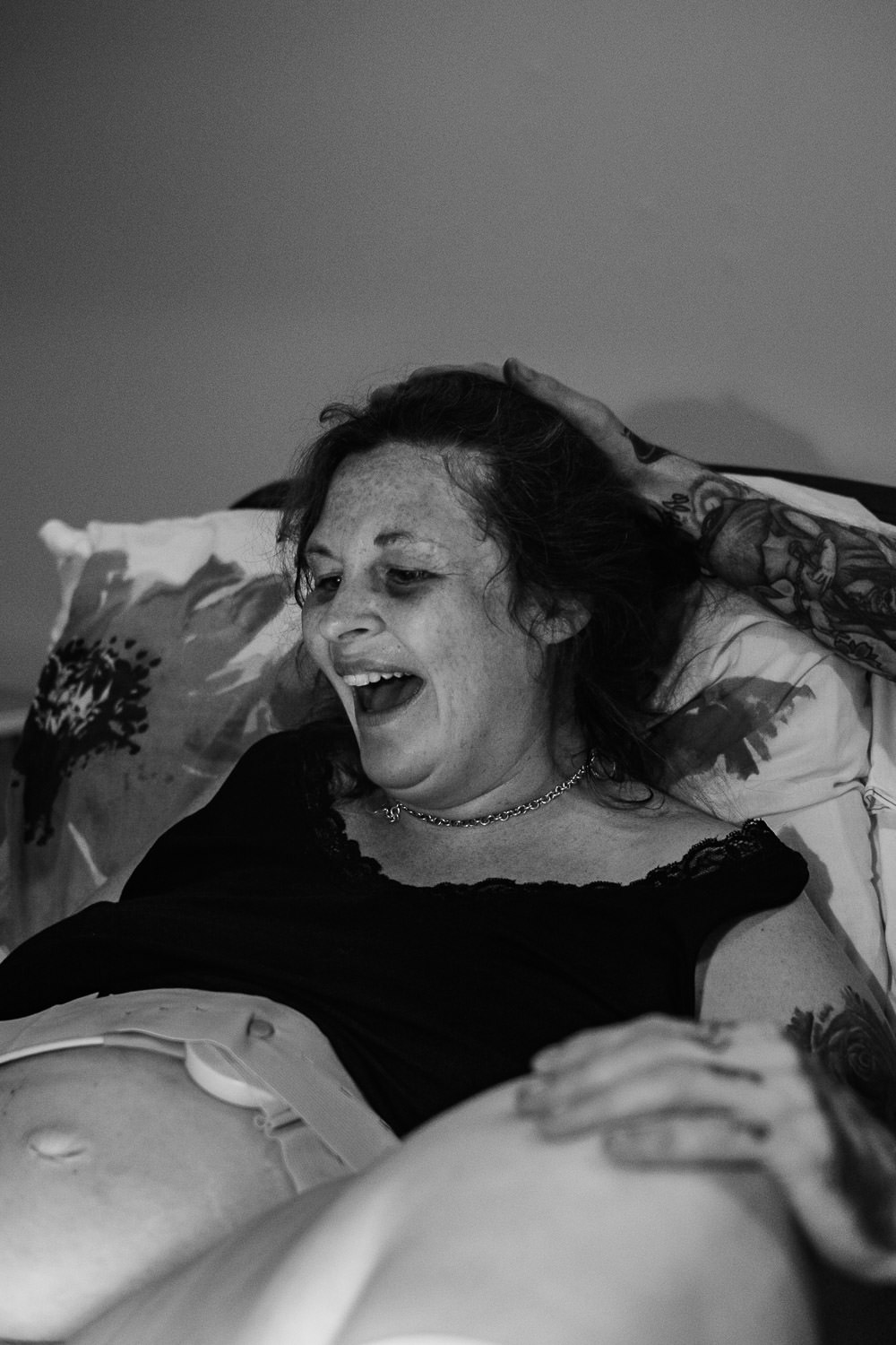The look of pure elation on mothers face as she sees her newborn for the first time.