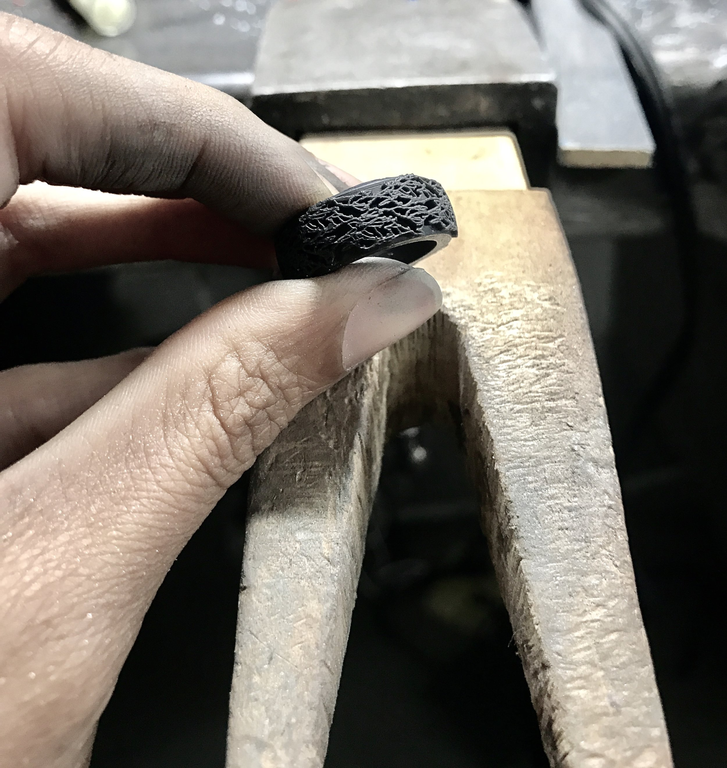 Jeweler at the bench, reviewing the quality of the 3D printed Prototype