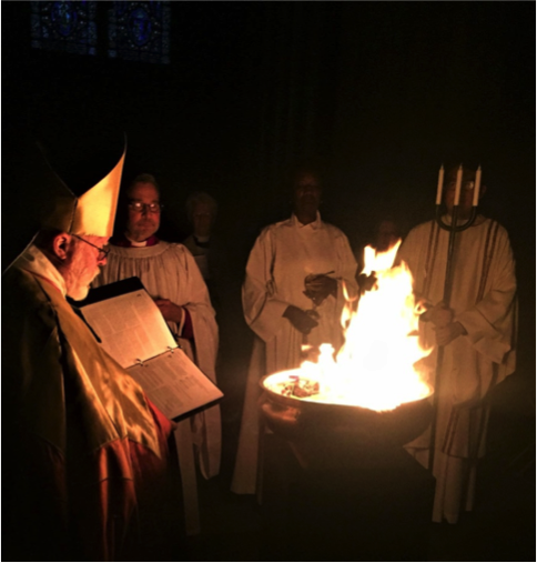 Bishop Andrew Dietsche lights the new fire of Easter.