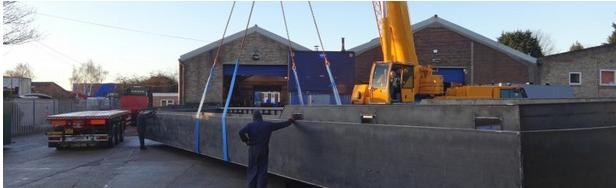 24 Metre floating home hull leaving the workshop