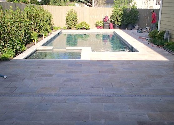 pool deck stone landscaping