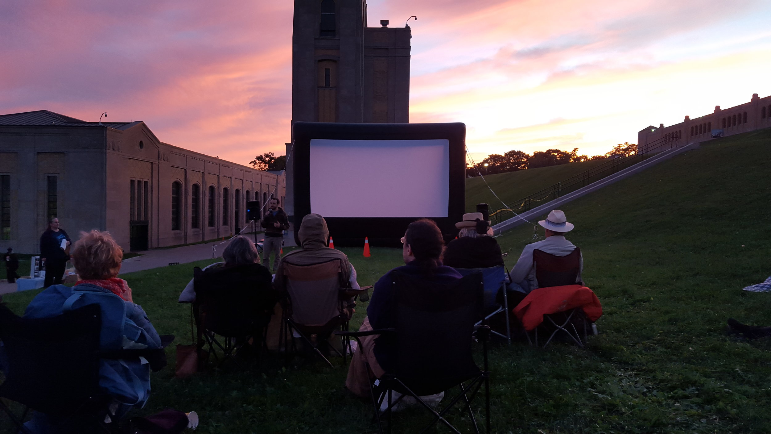 "Outdoor screening of ""Beyond Crisis"" at the R.C. Harris Water Filtration Plant by Lake Ontario in Toronto."