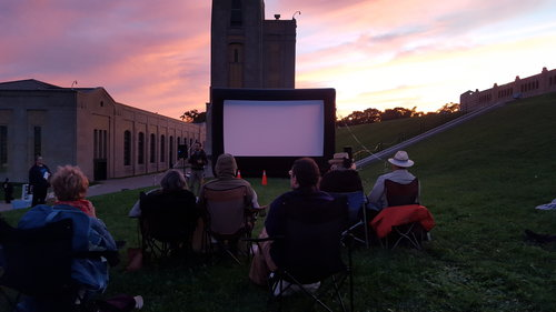 """Outdoor screening of """"Beyond Crisis"""" at the R.C. Harris Water Filtration Plant by Lake Ontario in Toronto."""