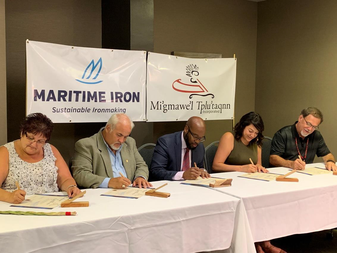 Seated from Left to Right: Chief Rebecca Knockwood, Co-Chair, MTI; Chief David Peter-Paul, Pabineau First Nation; Greg McKenzie, Chairman & CEO, Maritime Iron; Chief Sacha LaBillois, Eel River Bar First Nation; Chief George Ginnish, Co-Chair, MTI.