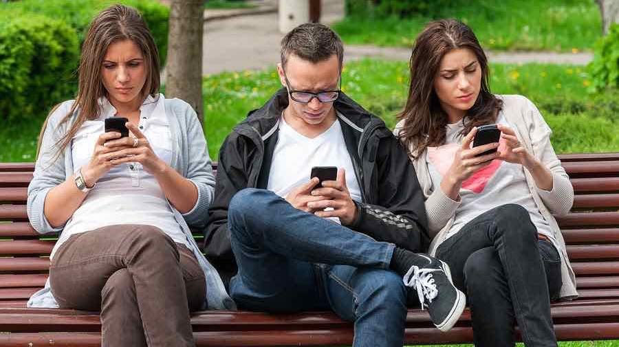 friends-all-looking-at-smartphones.jpg