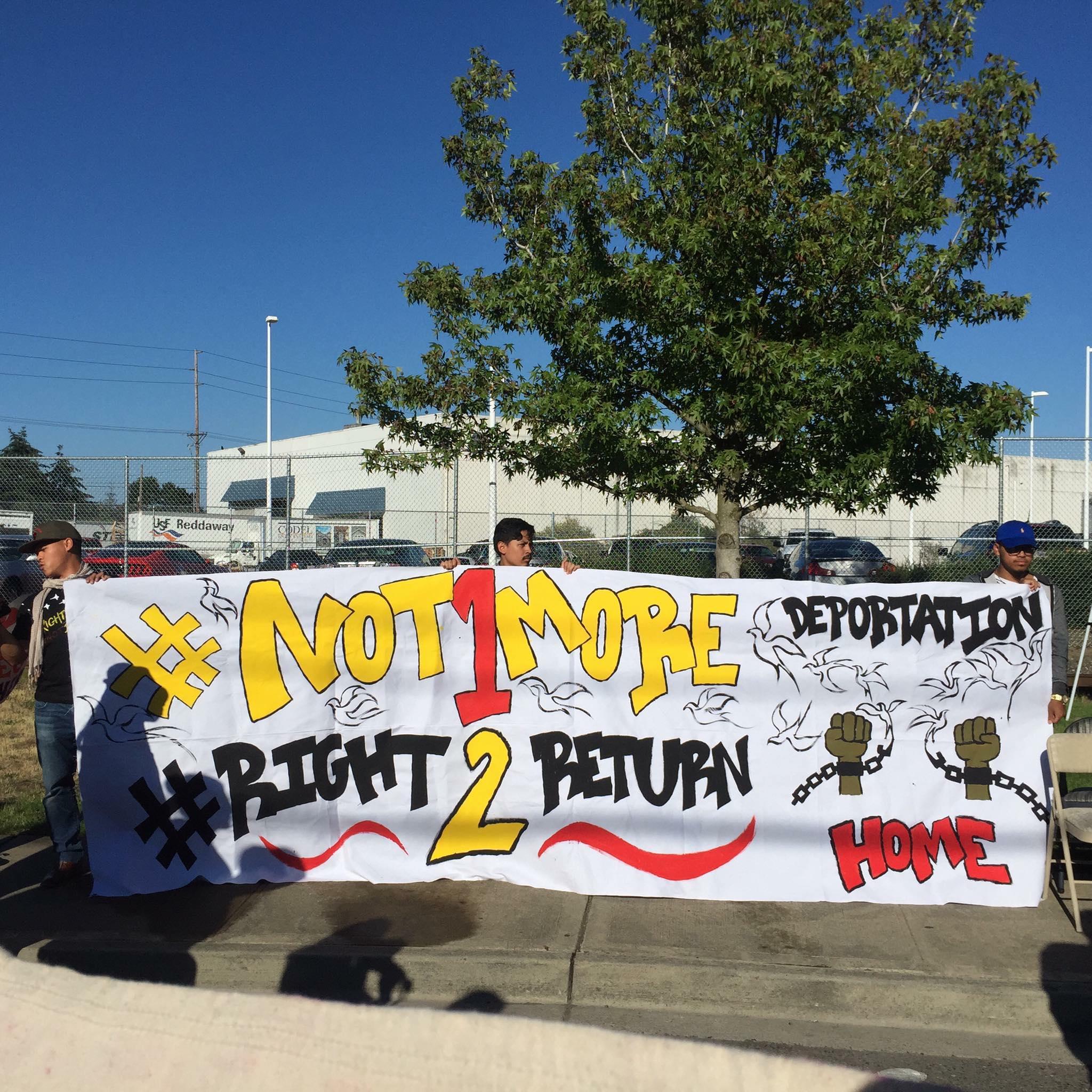 deportation rally banner.jpg