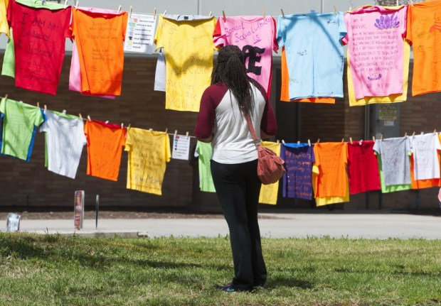 A Clothesline Project viewer. Image by Sam Gangwer via  The Orange County Register !