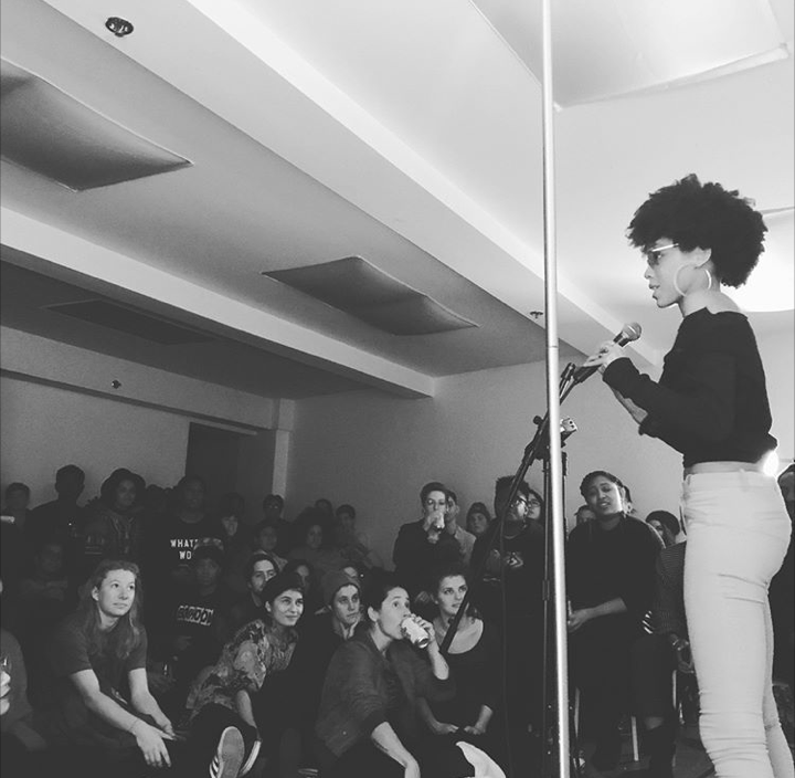 "Latiana performing at  Collective Sex's ""Queer Ancestor Stories,""  winter 2017"