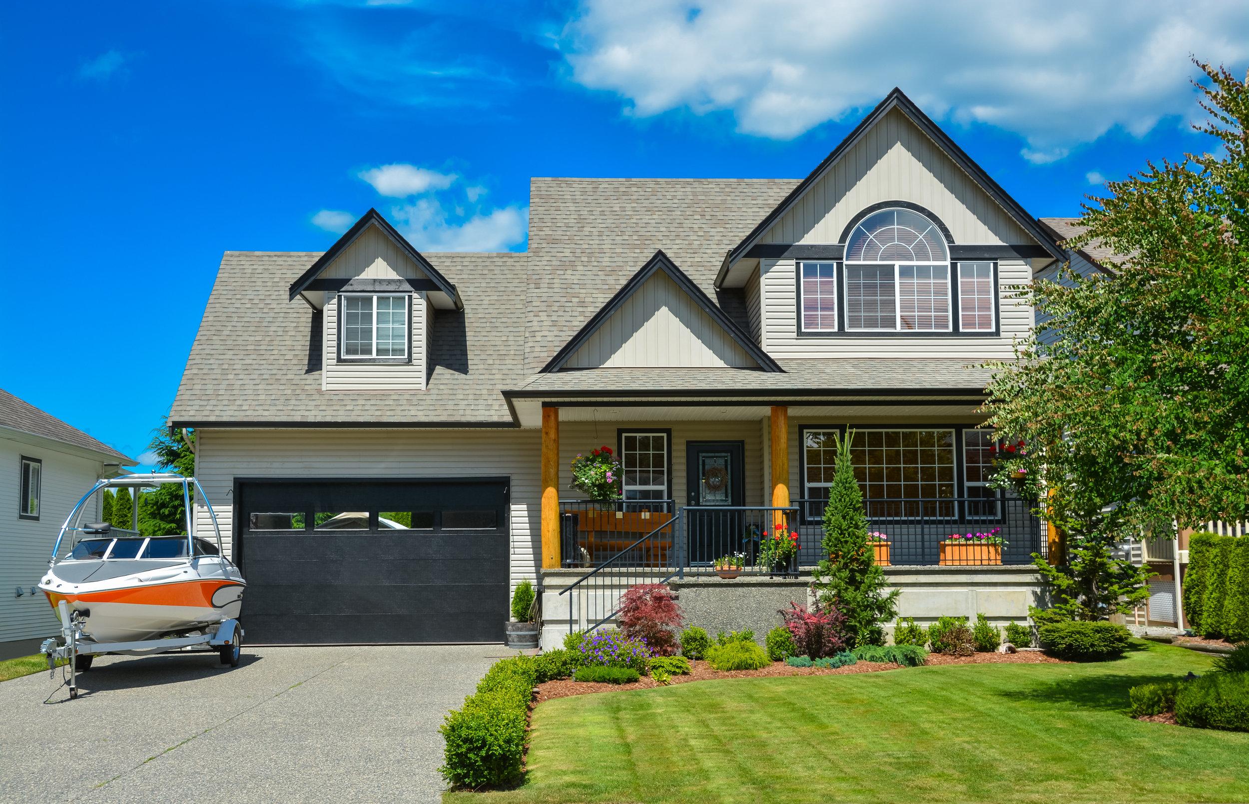 bigstock-Suburban-House-With-Landscapin-279609763.jpg