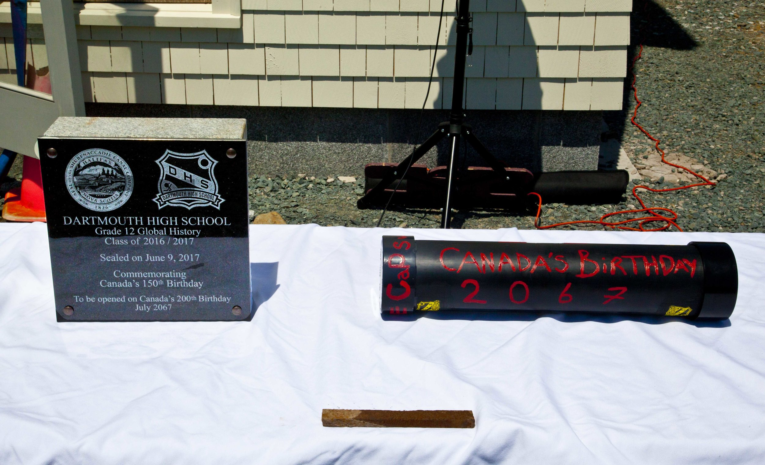 Plaque and time capsule on display at the event.