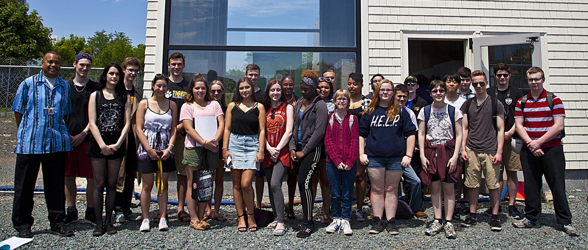 Dartmouth High School Global Geography student s with their teacher (L) Terry Sampson.