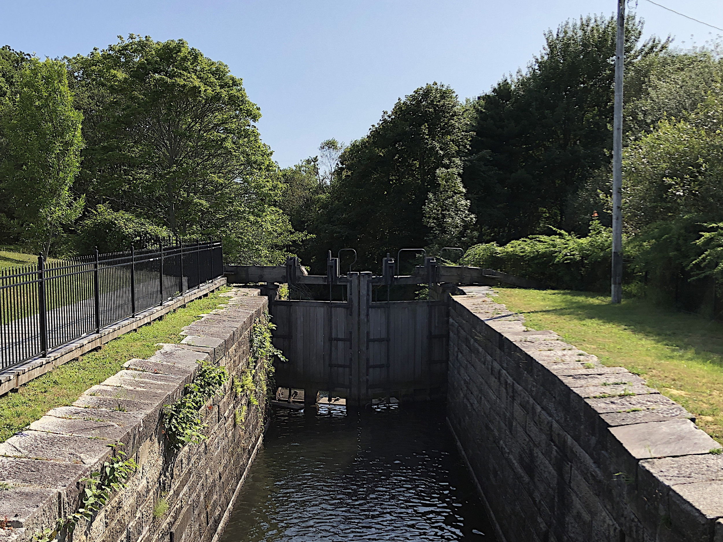The stone walls of  Lock 1  in Dartmouth are representative of the design used during the first construction phase.