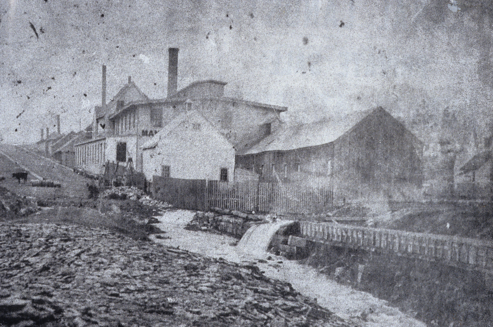 Starr Manufacturing Company visible alongside part of the Dartmouth marine railway. This factory expanded onto the former canal lands and continued to operate until 1996.