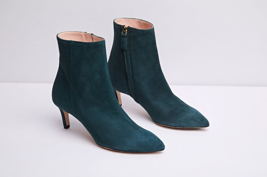 Get some height - Come the evening, you might feel you need a little height and this stylish on-point boot is the perfect answer. Roxy is cut to sit a little higher on your ankle making it a great match for jeans, dresses and the midi skirt which is so popular this season. They come in the on-trend forest green suede or luxurious black suede.ROXY green - £225