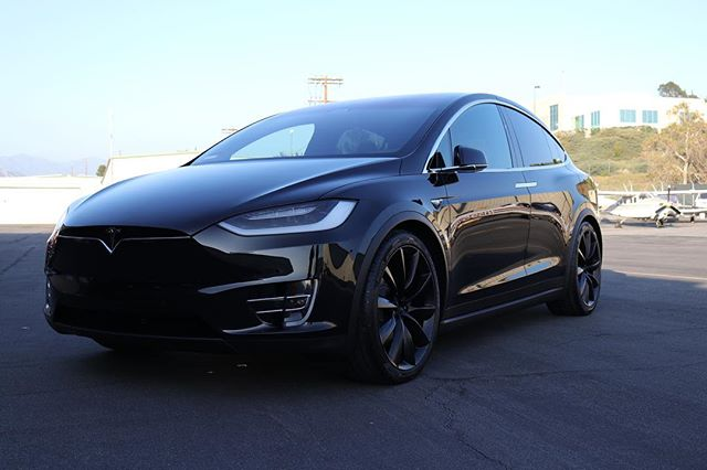 Nothing better than black 22's on a black Model X! This one received a pint correction with @opticoat Pro+. Who thinks this one needs a chrome delete? #tesla #teslamodelx #opticoat #opticoatproplus