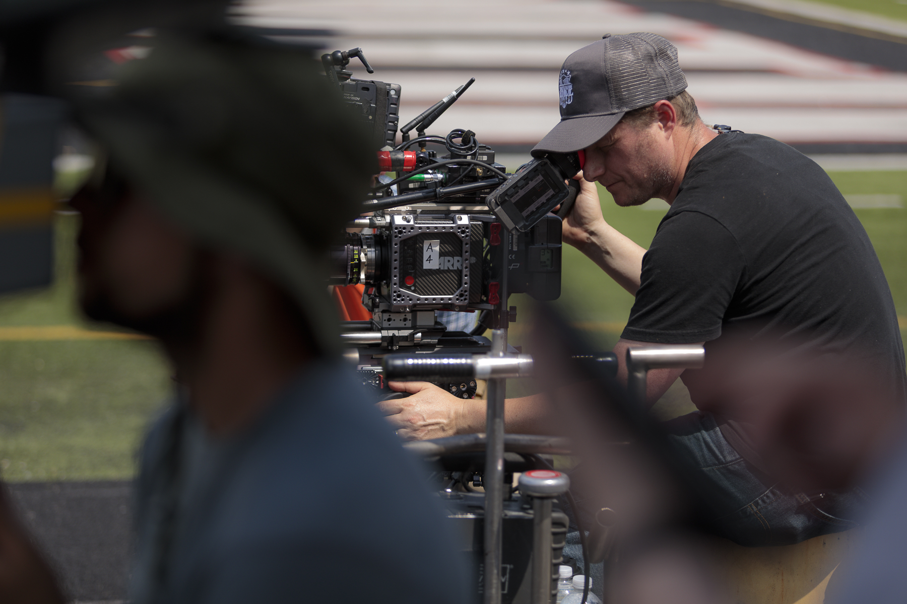 From front to back, Mike Fierros (1st Assistant Camera) and Darryl Miller (Director of Photography) work together to film a scene.  Photo credit,  Steve Serio .