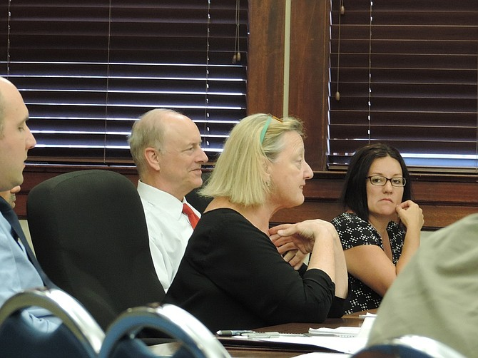 "Photo by  Kirby Neumann-Rea    PLANNING director Cindy Walbridge, center, speaks Monday about the ""thread"" that holds together Westside Concept Plan. With her are finance director Will Norris, city manager Steve Wheeler and city recorder Jennifer Gray."