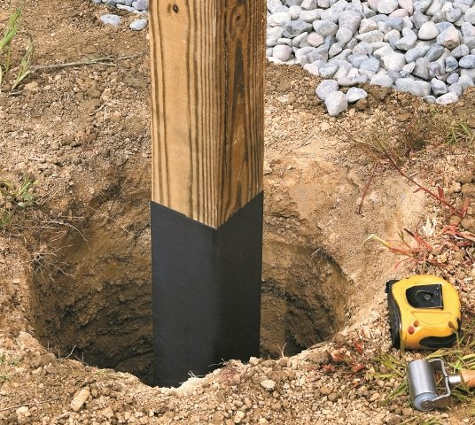 """Use 12"""" DeckWrap PowerBond® to wrap posts that will be submerged into the soil. This prevents premature rot and decay."""