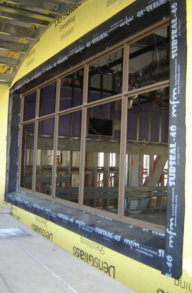 SubSeal meets AAMA 711-13 specifications as a window flashing membrane. These commercial windows were flashed using SubSeal.