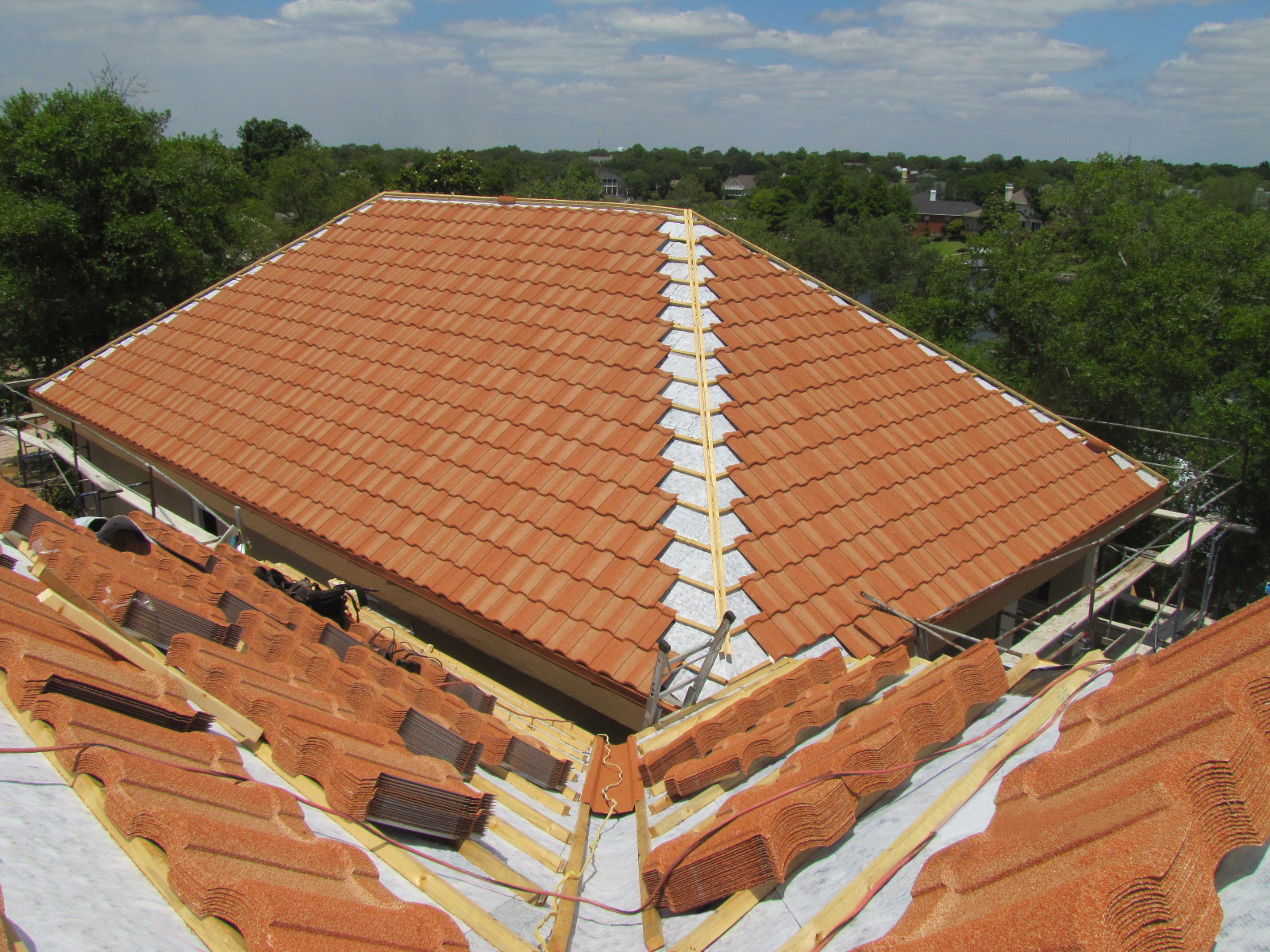 Premium HT Tile & Metal is designed as a whole roof covering. The product is a vapor barrier so ensure proper roof ventilation.