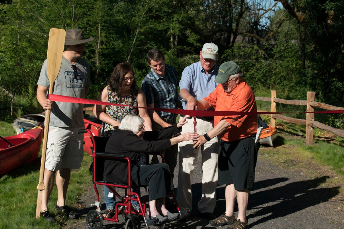 Officially open: Community leaders & former residents cut the ribbon