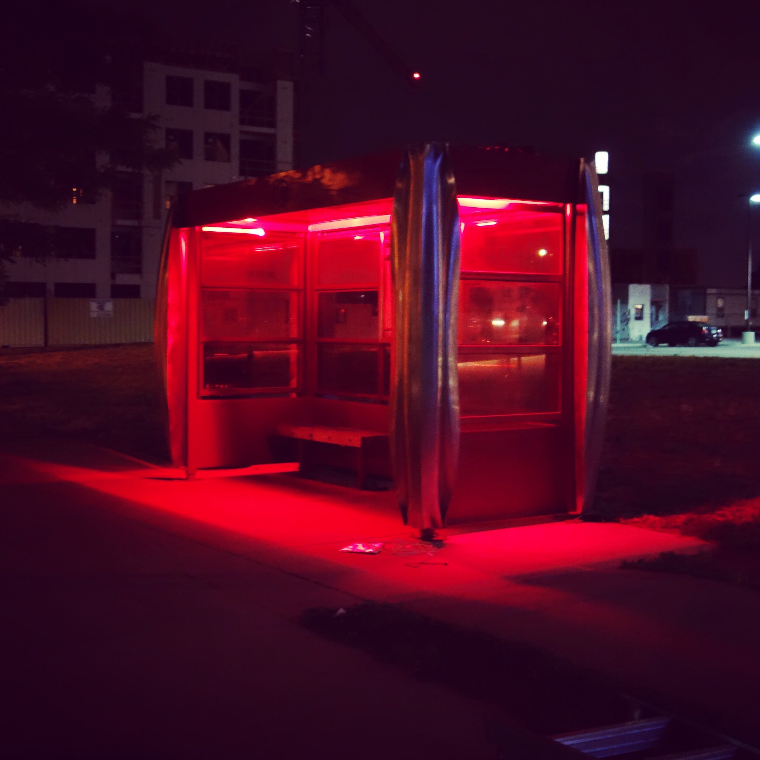 West Colfax BIPV Bus Stop Shelter | Red Glow Night